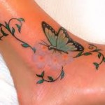 butterfly and vine tattoo