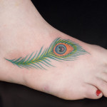 peacock feather on foot tattoo