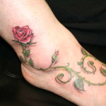rose and thorns on a foot tattoo
