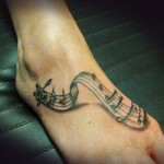 musical notes tattoo on foot