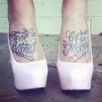 Chicano script tattoo on feet