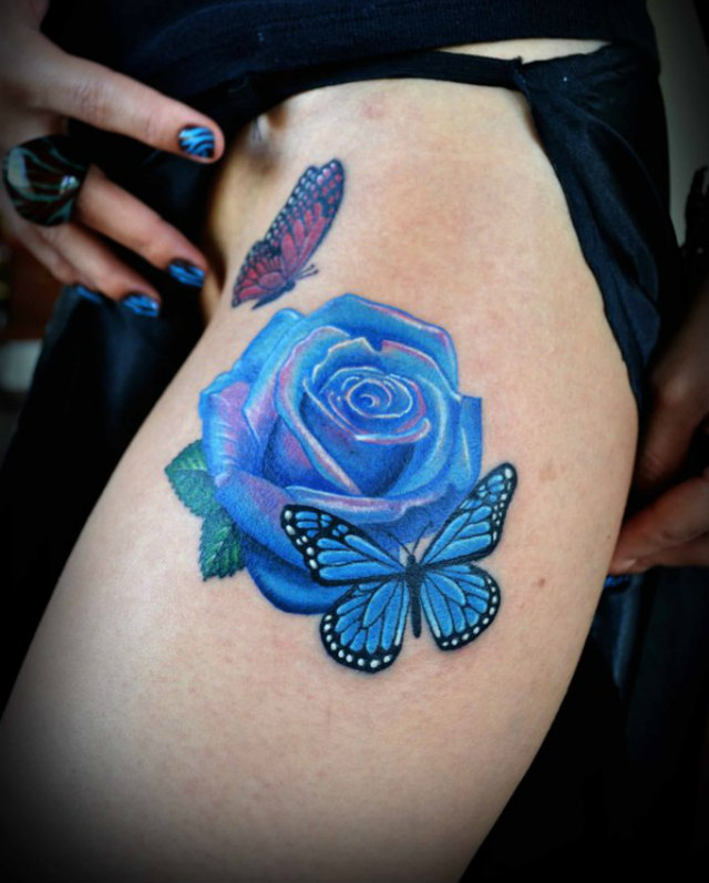 blue rose and butterfly thigh tattoos tattoo love. Black Bedroom Furniture Sets. Home Design Ideas