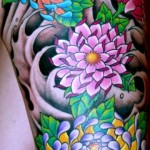 Colorful-Flowers-Tattoo-On-Thigh
