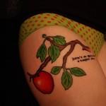 apple-branch-tattoo-on-thigh