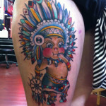 native-american-baby-boy-tattoo-on-thigh