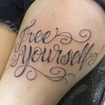 phrase-calligraphy-tattoo-on-thigh