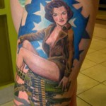 pin-up-girl-tattoos-on-women-thigh-730x1024