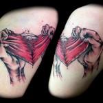 ripping-heart-thigh-tattoo