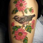 warbler-bird-with-flowers-stalk-tattoo-on-thigh
