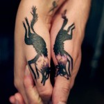 Women-hand-tattoos-wolves