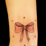 bow-and-twinkle-stars-tattoo-on-wrist