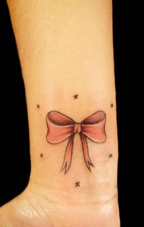 bow and twinkle stars tattoo on wrist tattoo love. Black Bedroom Furniture Sets. Home Design Ideas