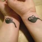 dinosaur-wrist-tattoo