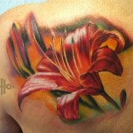 flower tattoo amazing painterly orange and green piece