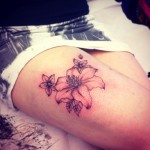 flower tattoo lily thigh piece