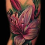 flower tattoo painterly pink lily side piece