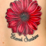 flower tattoo red daisy