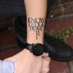 knowledge-is-power-arm-wrist-tattoo