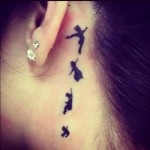 neck tattoo peter pan silhouette