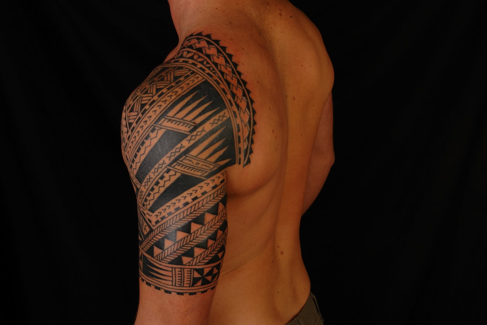 Religious half sleeve tribal tattoo designs tattoo love for Tribal half sleeve tattoos