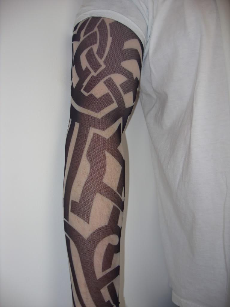Tribal-Tattoos Full-Sleeve-Classic-Tribal-Tattoo-Designs-For-Men