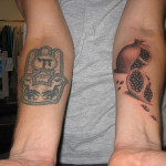 Skull Arm Classic Tattoo Designs